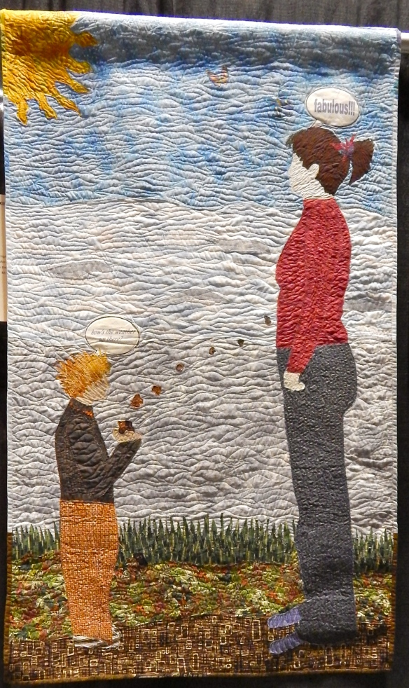 "This quilt portrays Carol being tormented by a bully in middle school. He would wait for her, throwing rocks and insults at her. Carol's sense of humor comes through--the boy's caption says ""how is the weather up there?"" And Carol is replying ""Fabulous."""